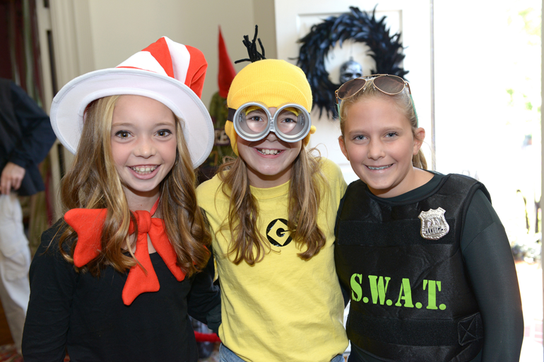 Young girls in Cat in the Hat Minion and SWAT costumes  sc 1 st  Classmates.com & From Scary Monsters to Superheroes: The Changing Face of Halloween ...